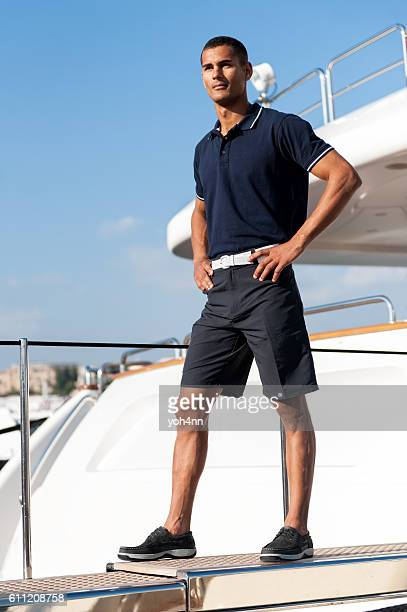 Young man standing on ferry
