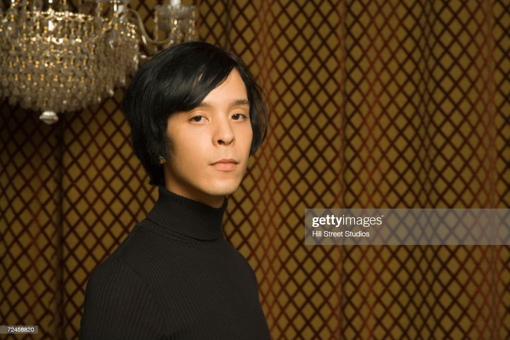 Young Man Standing Under Crystal Chandelier Stock Photo | Getty Images