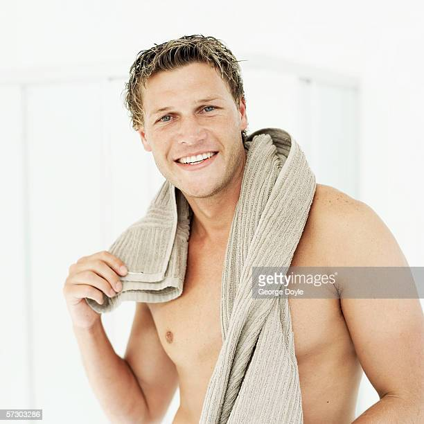 Young man standing with a towel around his neck