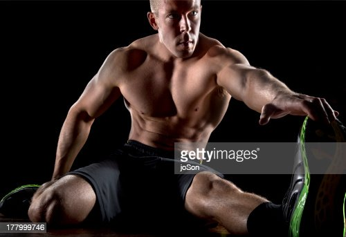 Young man stretching : Stock Photo