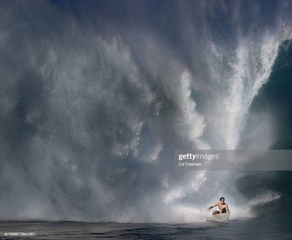 Young man surfing on wave : Stock Photo