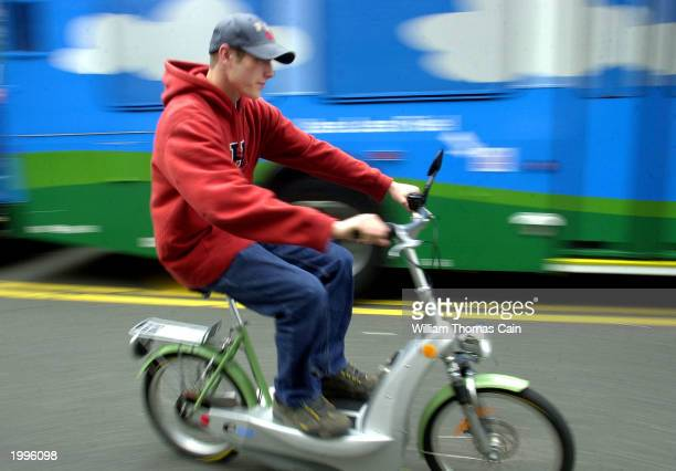 A young man takes a batterypowered Egovehicle bicycle for a test ride during the Tour de Sol The Great American Green Transportation Festival May 13...
