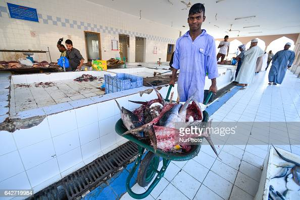 A young man takes away tuna heads and bones at a local fish market On Saturday February 18 in Samail Ad Dakhiliyah Region Oman