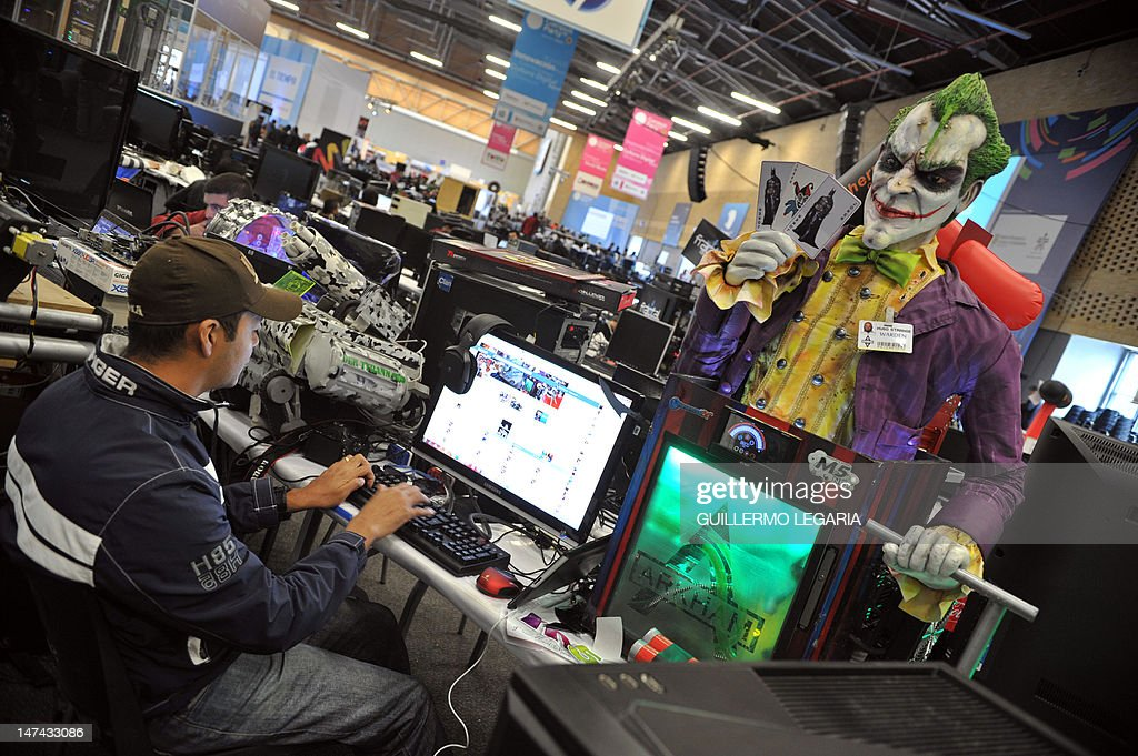 A young man takes part with his modded computer in the fifth edition of Colombia's Campus Party, on June 29, 2012, in Bogota. The Campus Party is considered the biggest event of technology, innovation, creativity, leisure and culture in the digital network world. AFP PHOTO/Guillermo LEGARIA