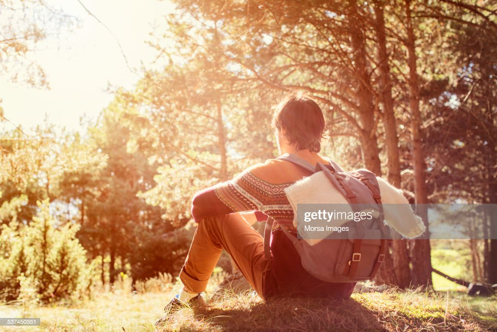 Young man taking a break in forest