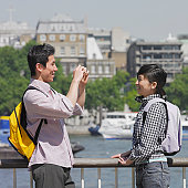 Young man taking photo of his girlfriend