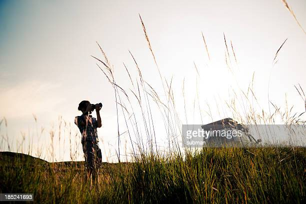 Young man taking pictures on safari