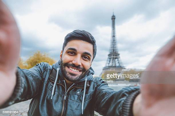 Young man taking selfie with smartphone
