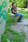 Young man talking on a mobile phone in a park