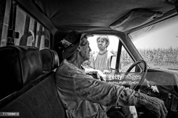 Young Man Talking With Truck Driver