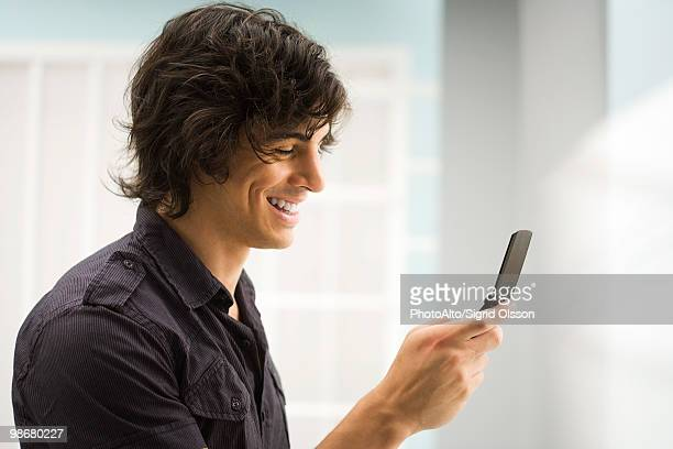 Young man text messaging