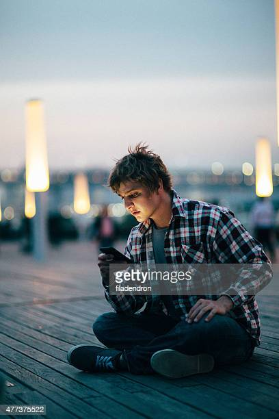 Young man texting on the phone