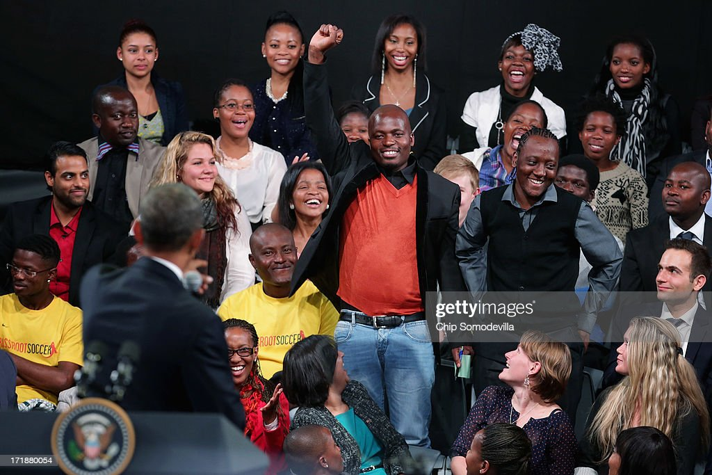 A young man throws his fist into the air as U.S. President Barack Obama calls on him for a question during a 'town hall' meeting with the young African leaders at the University of Johannesburg in Soweto June 29, 2013 in Johannesburg, South Africa. South Africa is the second leg of Obama's three-country tour of the African continent, which includes Senegal and Tanzania.