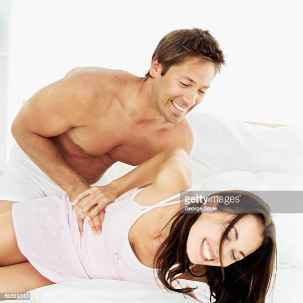 young man tickling a young woman