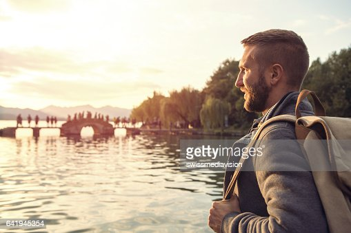 Young man traveling in China looks at landscape