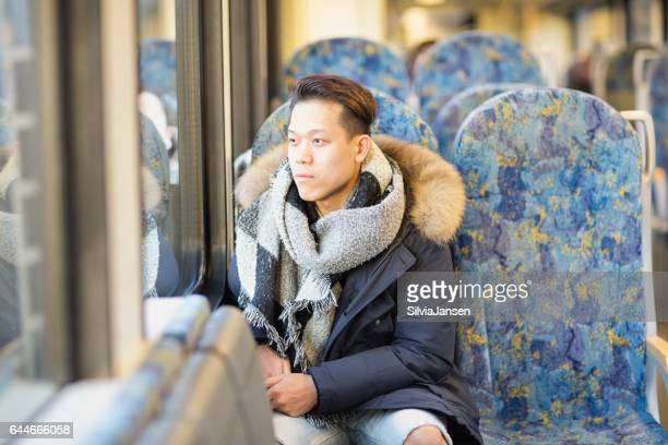 young man traveling in train