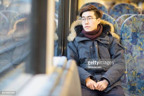young man traveling with train