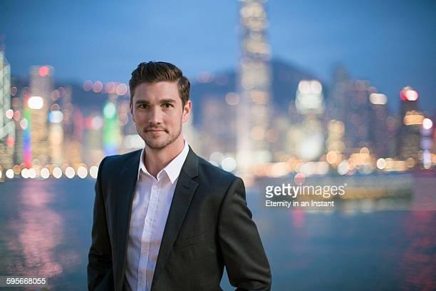 Young man travelling in Hong Kong at night.