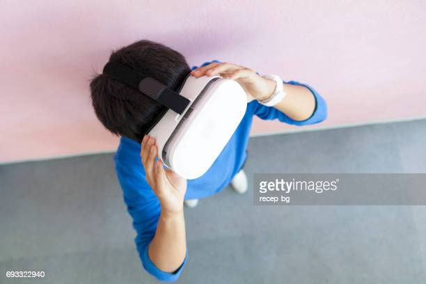 Young Man Trying Virtual Reality Device