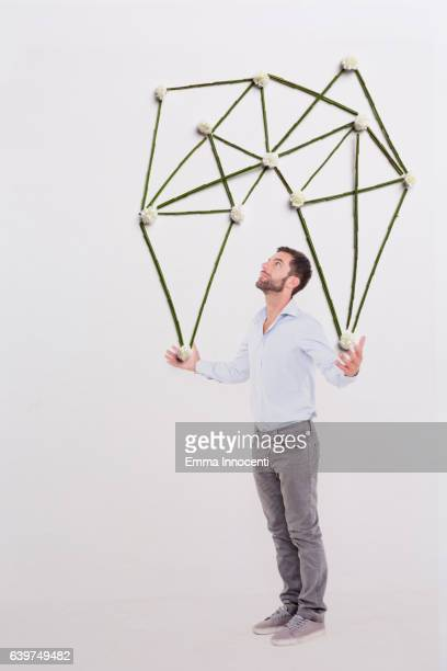 Young man under a parachute