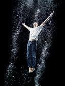 Young man under water posing like jesus