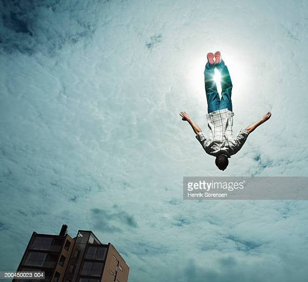 Young man upside down in air, low angle view