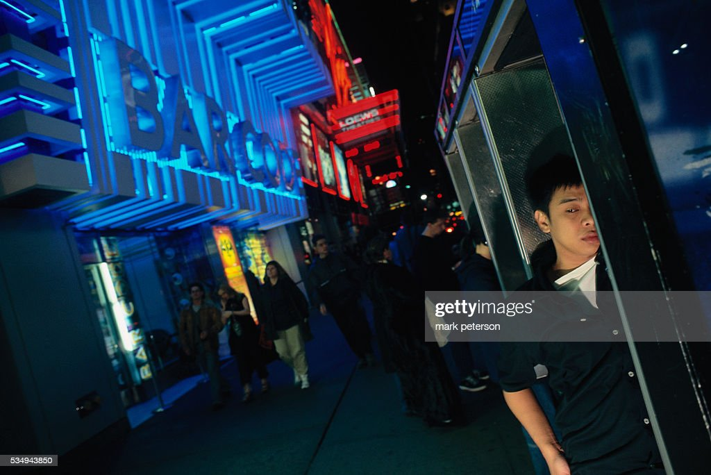 A young man uses a pay phone outside of Bar Code in New York Bar Code is a video arcade bar where DJs play music at night
