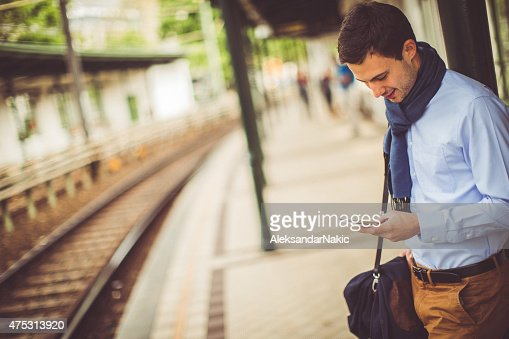 Young man using a smartphone on the train station