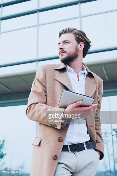 Young  man using a tablet computer outdoors