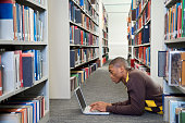 Young Man Using Computer in Library