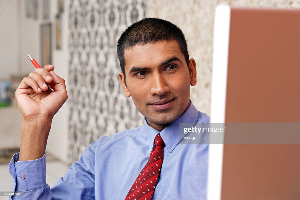Young man using computer : Stock Photo