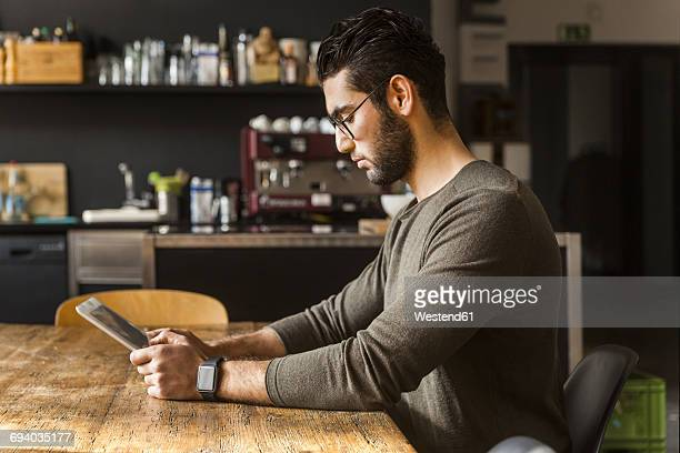 Young man using digital tablet in modern office