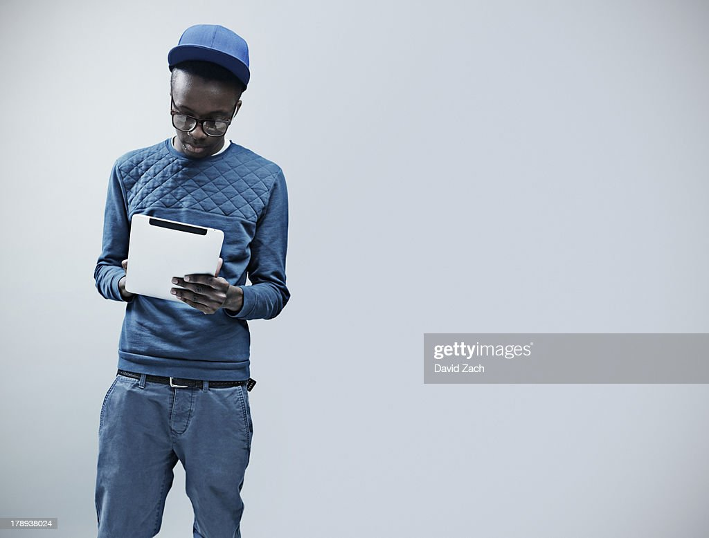 Young man using digital tablet : Stock Photo