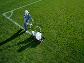 Young man using Field Line Marker, elevated view