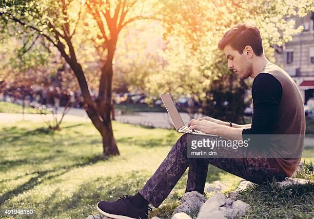 Young man using lap top