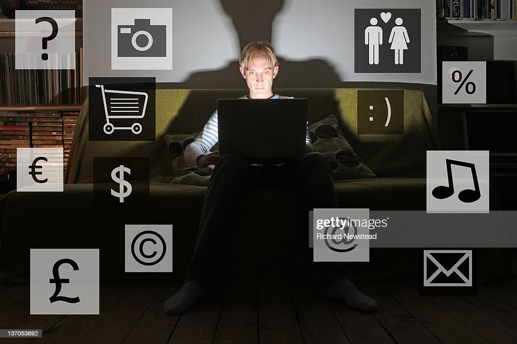 Young man using laptop : Stock Photo