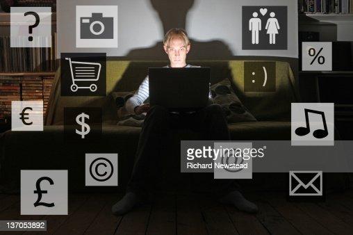Young man using laptop : Stock Photo