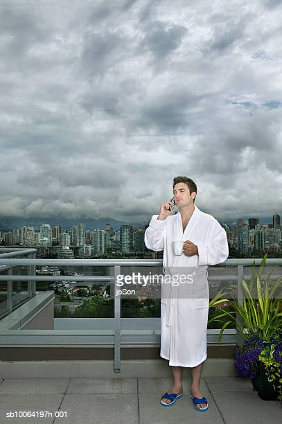 Young man using mobile phone on balcony