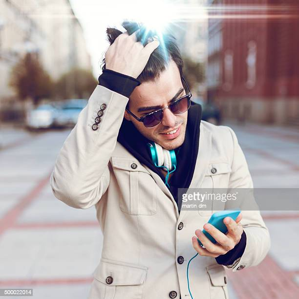 Young man using smartphone outside