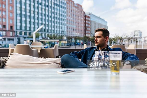 Young man waiting at outdoor cafe