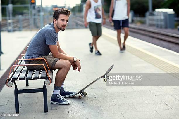 Young man waiting at train station