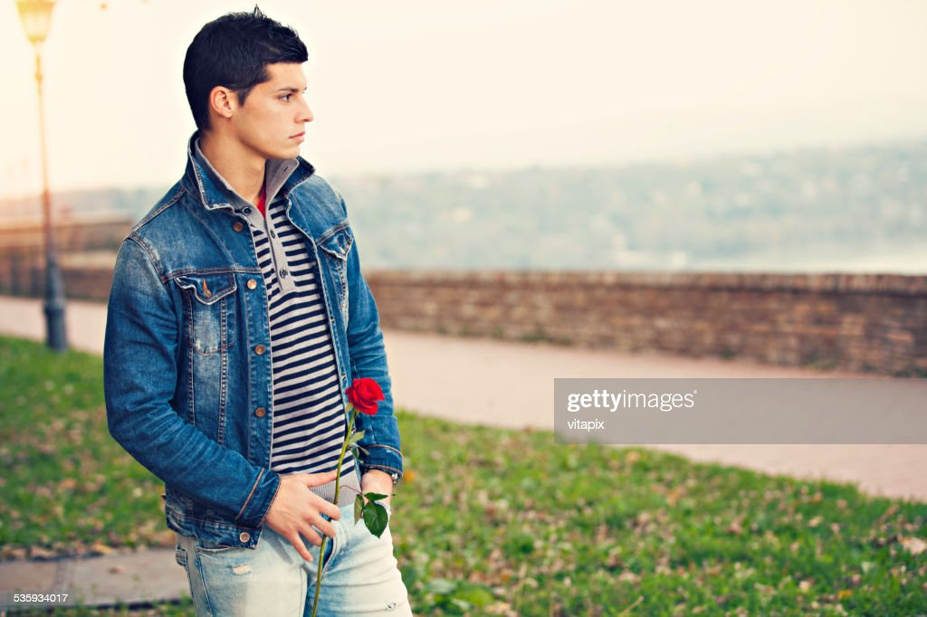 Young man waiting for his date : Stock Photo