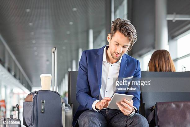 Young man waiting for his flight