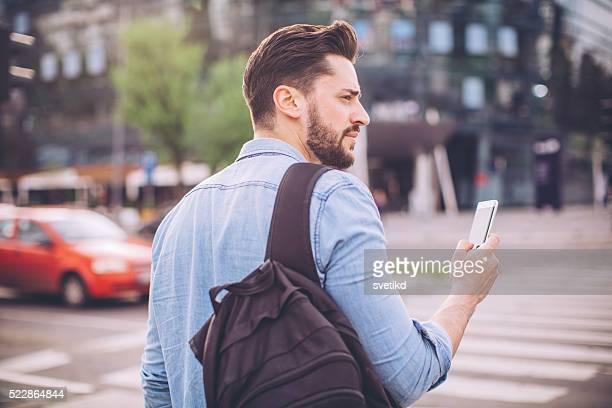 Young man waiting for taxi