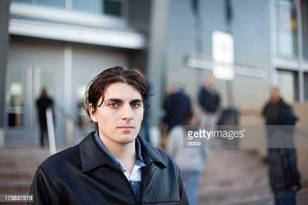 Young Man Waiting In Front Of a Building