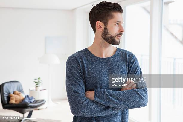Young man waiting in his living room