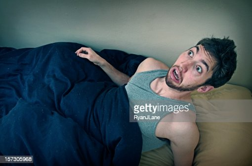 Young Man Wakes Up From Bad Dream