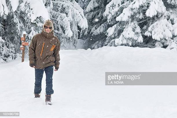 Young man walking in snow
