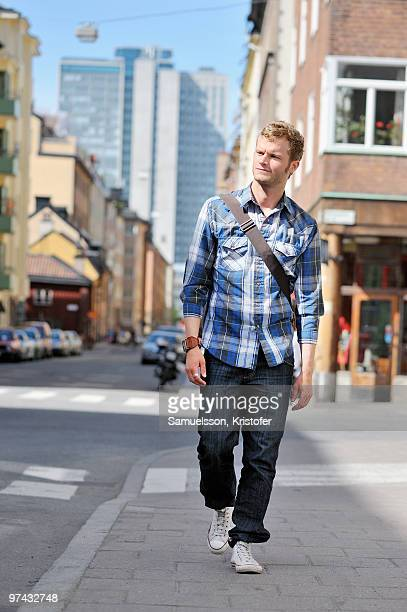 Young man walking on a street, Sweden.