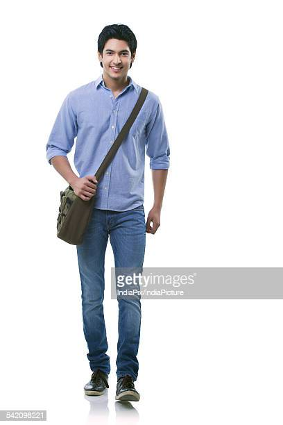Young man walking over white background